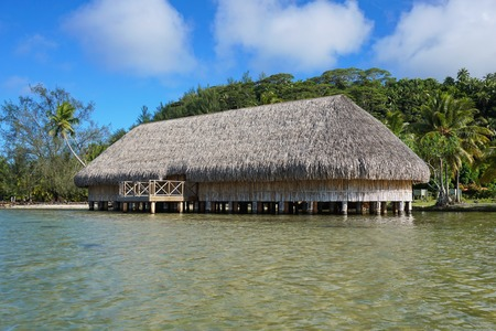 stilts: The Fare Potee built on stilts over the water on the shore of the lake Fauna Nui, Maeva, Huahine island, French Polynesia
