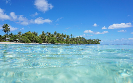 turquoise water: Tropical shore with turquoise water near Maeva village of Huahine island, seen from the ocean surface in the lagoon, Pacific, French Polynesia