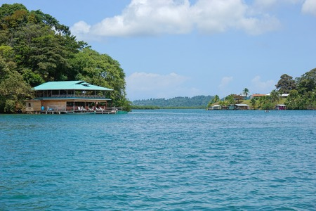 bocas del toro: Canal Loma Partida in the archipelago of Bocas del Toro with a restaurant over the water on the left side, Panama, Caribbean sea, Central America Stock Photo