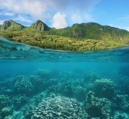 Above and below water surface with lush coast and coral reef underwater split by waterline, Huahine island, Maroe bay, Pacific ocean, French Polynesia Stock Photo