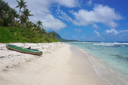 polynesia: Kayak on a sandy beach, motu Muri Mahora, Huahine island, Pacific ocean, French Polynesia Stock Photo