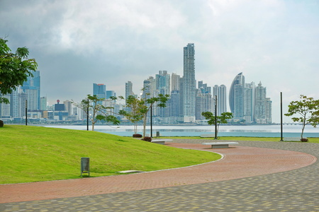 Oceanfront walkway in Panama City with skyscrapers and cloudy sky, Panama, Central America
