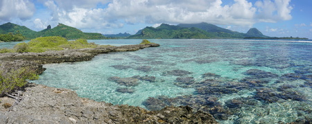 islet: Panorama of Huahine island with shallow water of its lagoon, seen from an islet, near Maroe bay, Pacific ocean, French Polynesia