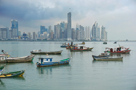 panama city: Fishing boats anchored with skyscrapers of Panama City in background, Pacific coast, Central America