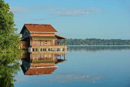 calm water: Wooden tropical home on stilts over calm water in a bay, Bocas del Toro archipelago, Caribbean sea, , Central America Stock Photo