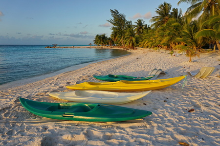 south pacific ocean: Kayaks on sandy tropical beach with coconut palm trees, atoll of Tikehau, Tuamotu archipelago, French Polynesia, south Pacific ocean