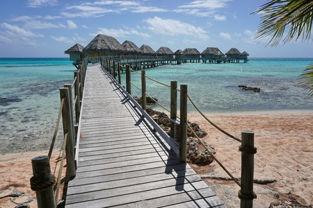 south pacific ocean: Wooden footbridge to the overwater bungalows of a resort on the atoll of Tikehau, Tuamotu archipelago, French Polynesia, south Pacific ocean
