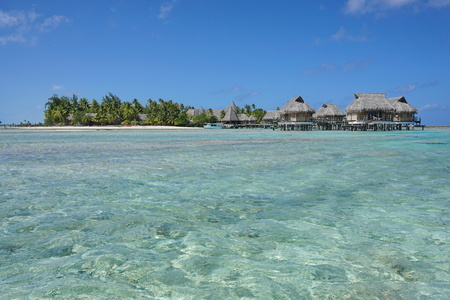 motu: Tropical resort on a islet with overwater bungalows, atoll of Tikehau, Tuamotu archipelago, French Polynesia, south Pacific ocean