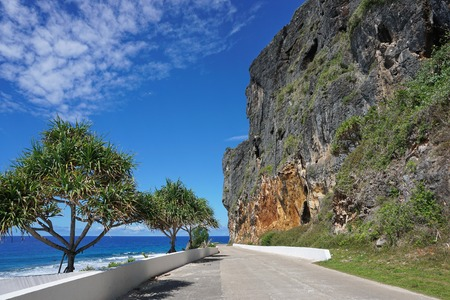 coastal erosion: Eroded limestone cliff along the coastal road of Rurutu island, Pacific ocean, Austral archipelago, French Polynesia