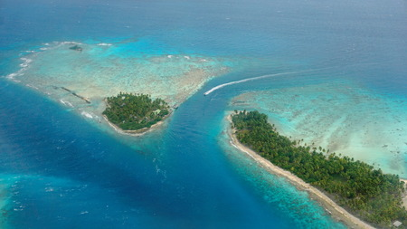 Aerial view of tropical islet with lagoon and channel, Avatoru pass, atoll of Rangiroa, Tuamotu archipelago, French Polynesia