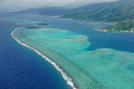 The lagoon and barrier reef of Raiatea island, aerial view, south Pacific ocean, Society islands, French Polynesia 스톡 콘텐츠