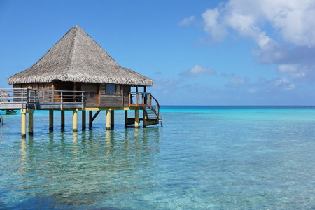 south pacific ocean: Overwater bungalow with thatched roof in the lagoon of Rangiroa, south Pacific ocean, Tuamotu, French Polynesia