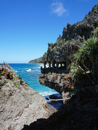 Eroded limestone cliff that looks like monster mouth on the coast of Rurutu island, Pacific ocean, Austral archipelago, French Polynesia
