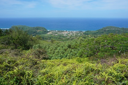 south pacific ocean: Viewpoint from the heights of the island of Rurutu with the coastal village of Auti, south Pacific ocean, Austral archipelago, French Polynesia