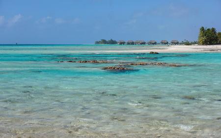 atoll: Lagoon of the atoll of Tikehau with overwater bungalows in background, Tuamotu archipelago, French Polynesia, Pacific ocean