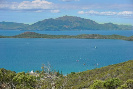 Sainte Marie bay and island with the mountain Mont Dore in background, seen from the Ouen Toro parc in Noumea city, Grande Terre, New Caledonia, south Pacific Stock Photo