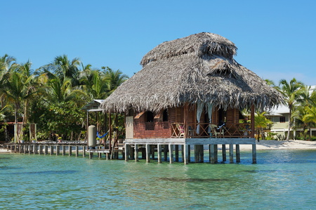 Overwater bungalow with thatch roof, Bastimentos island, Bocas del Toro, Caribbean, Panama