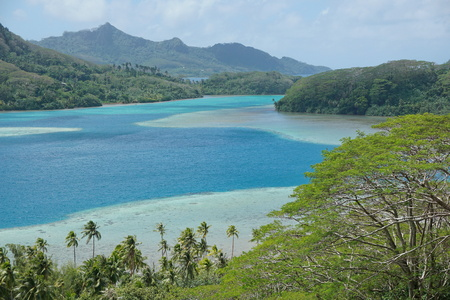 Huahine island landscape with blue water of Bourayne bay, south Pacific ocean, French Polynesia