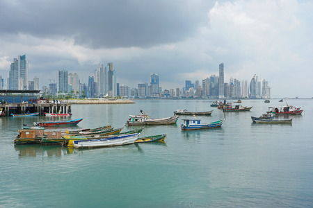 Panama city fishing boats anchored with skyscrapers buildings, Pacific coast, Central America