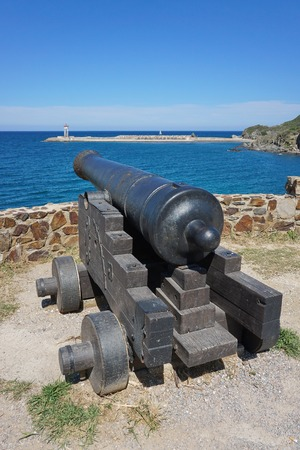 port vendres: Old canon on the coast in the harbor of Port-Vendres, Mediterrean sea, Cote Vermeille, Roussillon, Pyrenees Orientales, south of France Stock Photo