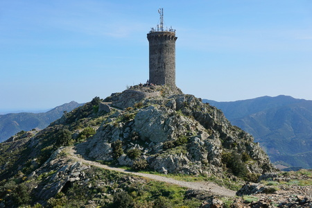 vermilion coast: Medieval watchtower the Madeloc old stone tower at about 650 meters in height in the Albera massif, Mediterranean, Pyrenees Orientales, Roussillon, south of France Stock Photo