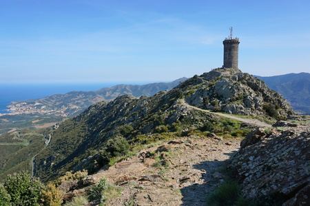 vermilion coast: The Madeloc medieval watchtower, old stone tower overlooking the Vermilion coast, Mediterranean, Pyrenees Orientales, Roussillon, south of France