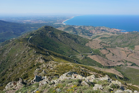 vermilion coast: Landscape from the mountains of the massif des Alberes overlooking the Vermilion coast, Collioure and the Roussillon plain in background, Mediterranean sea, Pyrenees Orientales, south of France Stock Photo
