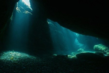 Underwater cave with sunlight from a hole, natural scene, Mediterranean sea, Pyrenees Orientales, Roussillon, France Imagens