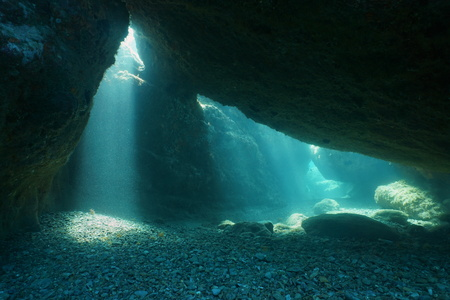 Below big rocks underwater with sunbeam from hole, Mediterranean sea, natural scene, Pyrenees Orientales, Roussillon, France