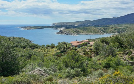 Spain Costa Brava rocky coastal landscape with an house near Cadaques, Guillola bay, Mediterranean sea, Cap de Creus, Catalonia Stock Photo
