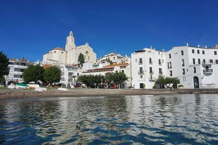 Spain Mediterranean village of Cadaques, beach with whitewashed houses and the church Santa Maria, Costa Brava, Alt Emporda, Catalonia, Cap de Creus Stock Photo