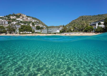 Over and under sea surface, Mediterranean beach and sand underwater,  Spain, Costa Brava, playa Almadrava, Canyelles Grosses, Roses, Girona, Catalonia