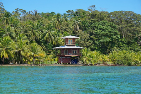 Waterfront tropical house and vegetation on the Caribbean island of Bastimentos, Bocas del Toro, Panama, Central America Editorial