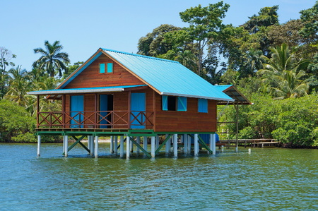 Bungalow on stilts over water of the Caribbean sea, Bocas del Toro, Panama