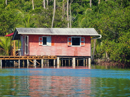 small Caribbean house on stilts over water in the archipelago of Bocas del Toro, Central America, Panama