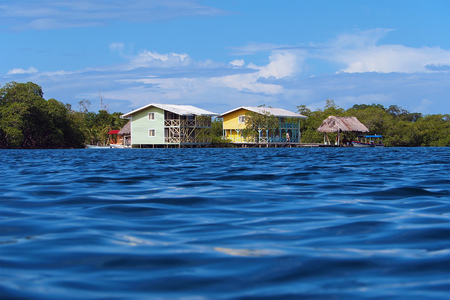 Hotel over water in the Caribbean viewed from sea surface Editorial
