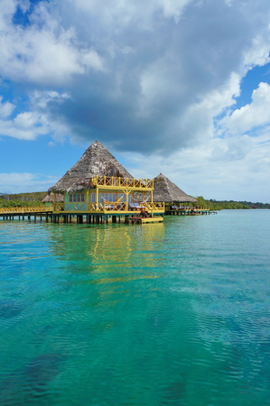 Caribbean resort overwater with thatched roof, Bocas del Toro, Central America, Panama