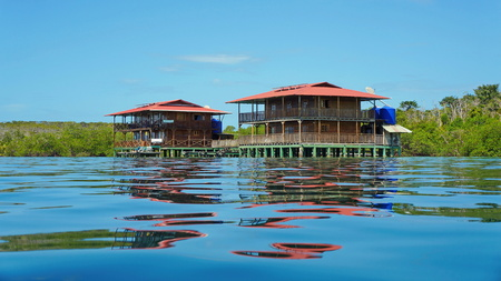 Caribbean hotel on stilts over water viewed from sea surface, Panama, Central America Editorial