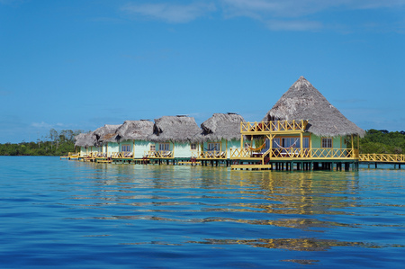 bungalows over water with thatched roof, Caribbean sea, Bocas del Toro, Panama Editorial