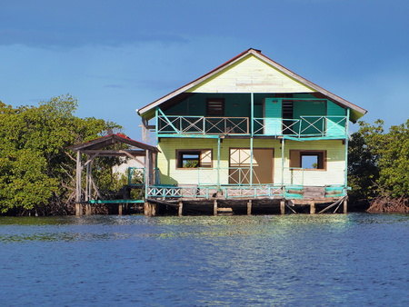 Abandoned and damaged house on stilts over the water, Caribbean sea, Bocas del Toro, Panama Editorial