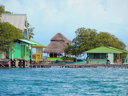 Cabin and houses over water with mangrove trees, Caribbean sea, Cayo coral, Bocas del Toro, Panama