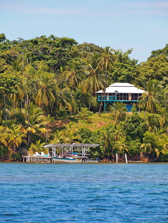 Tropical land at the edge of the Caribbean sea with a dock and an house, Bocas del Toro, Panama