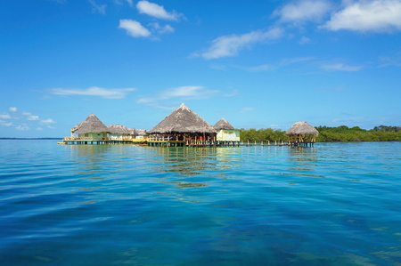 Tropical resort overwater with thatched roofs, Caribbean sea, Bocas del Toro, Panama, Central America