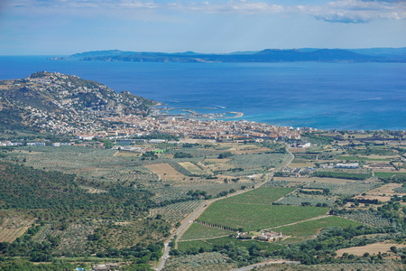 Spain aerial view over the city of Roses on the shore of the Mediterranean sea with olive groves and vineyards fields, Costa Brava, Girona, Catalonia, Alt Emporda