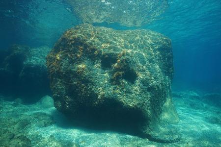 A large rock underwater below water surface in the Mediterranean sea, Costa Brava, Cap de Creus, Catalonia, Spain