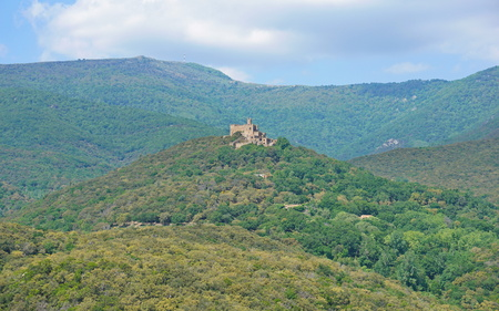 The castle of Requesens on the top of the hill with the peak Neulos in background, Albera massif, la Jonquera, Alt Emporda, Girona, Catalonia, Spain Reklamní fotografie