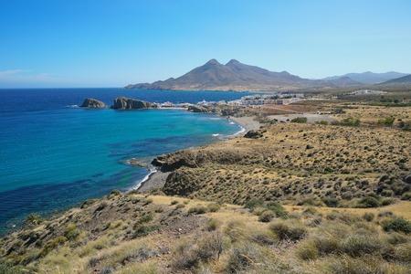 Coastal landscape the village La Isleta del Moro with the massif of Los Frailes in background in the Cabo de Gata-Níjar natural park, Mediterranean sea, Almeria, Andalusia, Spain