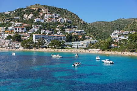 Spain Costa Brava coastal town with sandy beach and boats anchored near the shore, Mediterranean sea, playa Almadrava, Canyelles Grosses, Roses, Girona, Catalonia