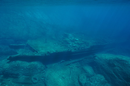 Underwater a shipwreck on rocky bottom in the Mediterranean sea ( 1968, the ship Melchuca ), Catalonia, Costa Brava, Spain