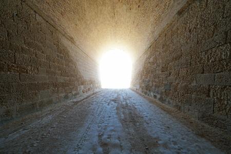 Inside a tunnel with bright light at the end, natural scene, L'Ametlla de Mar, Tarragona, Catalonia, Spain